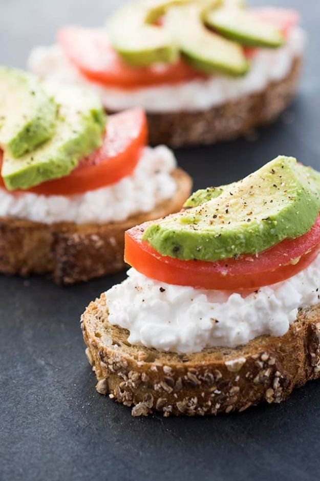 Best Recipes for the Cheese Lover - Avocado Toast With Cottage Cheese and Tomatoes - Easy Recipe Ideas With Cheese - Homemade Appetizers, Dips, Dinners, Snacks, Pasta Dishes, Healthy Lunches and Soups Made With Your Favorite Cheeses - Ricotta, Cheddar, Swiss, Parmesan, Goat Chevre, Mozzarella and Feta Ideas - Grilled, Healthy, Vegan and Vegetarian #cheeserecipes #recipes #recipeideas #cheese #cheeserecipe
