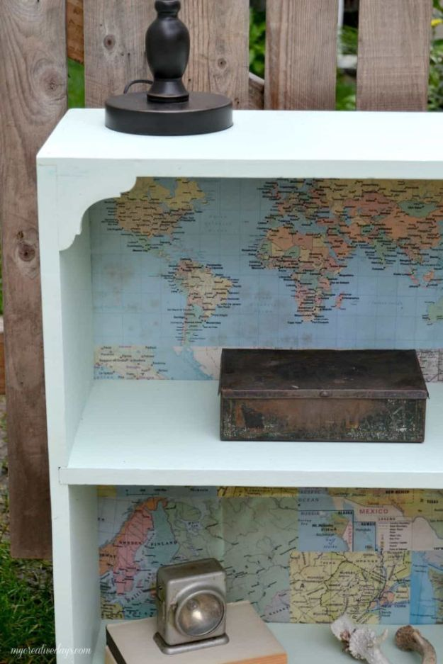DIY Ideas With Maps - Bookshelf Makeover With Maps - Easy Crafts, Home Decor, Art and Gifts Your Can Make With A Map - Pinboard, Canvas, Painting, Paper Flowers, Signs Projects
