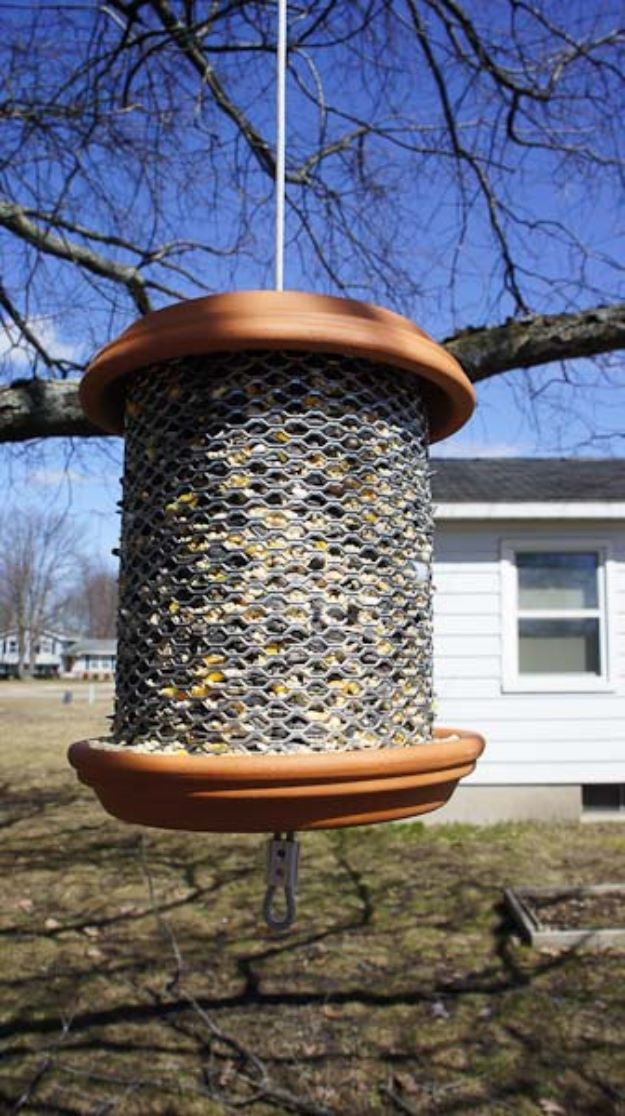 DIY Bird Feeders - Ceramic Saucer Bird Feeder - Easy Do It Yourself Homemade Bird Feeder Ideas from Mason Jar, Wooden, Wine Bottle, Milk Jug, Plastic, Dollar Store Supplies - Squirrel Proof, Unique and Creative Tutorials That Make Cool DIY Gifts #diyideas #birds
