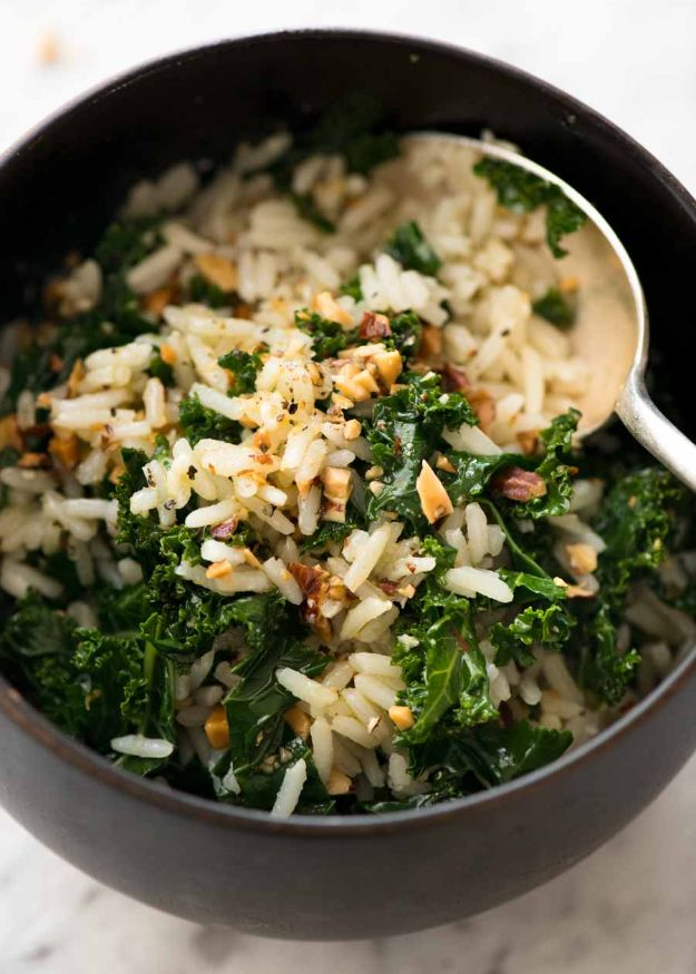 Best Kale Recipes - Garlic Butter Rice With Kale - How to Cook Kale at Home - Healthy Green Vegetable Cooking for Salads, Soup, Lunches, Stir Fry and Dinner - Kale Chips. Salad, Shredded, Cooked, Fresh and Sauteed Kale - Vegan, Vegetarian, Keto, Low Carb and Lowfat Recipe Ideas #kale #kalerecipes #vegetablerecipes #veggies #recipeideas #dinnerideas http://diyjoy.com/best-kale-recipes