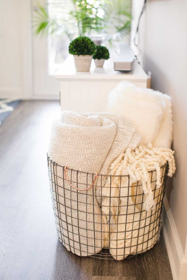 Dollar Store Organizing Ideas - Lightweight Wire Guest Bedding Tote - Easy Organization Projects from Dollar Tree and Dollar Stores - Quick Closet Makeovers, Pantry Storage, Shoe Box Projects, Tension Rods, Car and Household Cleaning - Hacks and Tips for Organizing on a Budget - Cheap Idea for Reducing Clutter around the House, in the Kitchen and Bedroom http://diyjoy.com/dollar-store-organizing-ideas