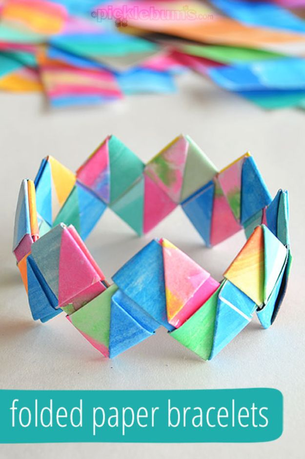 Paper Crafts DIY - Folded Paper Bracelets - Papercraft Tutorials and Easy Projects for Make for Decoration and Gift IDeas - Origami, Paper Flowers, Heart Decoration, Scrapbook Notions, Wall Art, Christmas Cards, Step by Step Tutorials for Crafts Made From Papers http://diyjoy.com/paper-crafts-diy