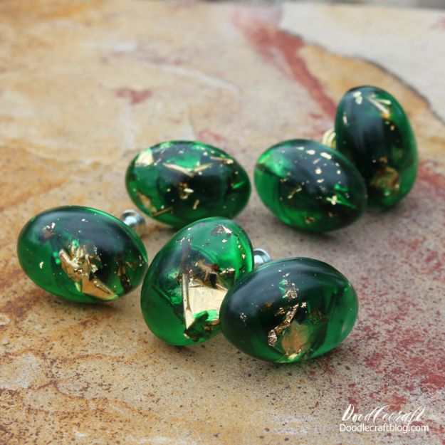 DIY Resin Casting Crafts - Gold Leaf and Emerald Resin Cabinet Knobs - Homemade Resin and Epoxy Craft Projects and Ideas - How to Make Resin Jewelry - Use Silicon Molds to Make Paper Weights, Creative Christmas Ornaments and Crafts to Make and Sell - Flowers, Pictures, Clocks, Tabletop, Inspiration for Handmade Jewelry and Items to Sell on Etsy #crafts
