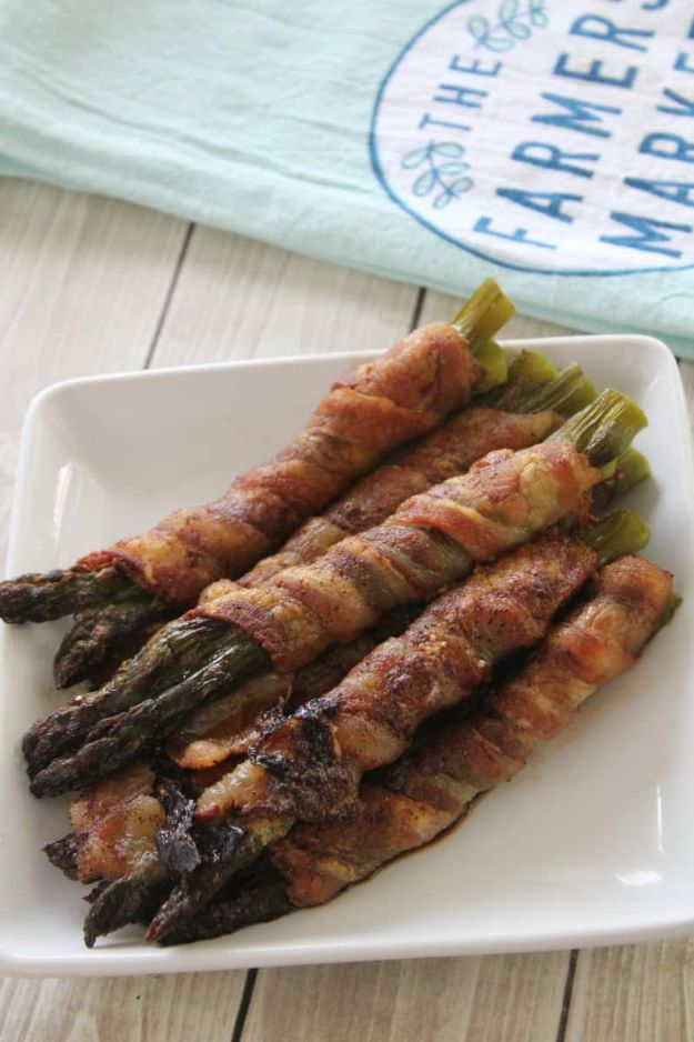 Keto Snacks - Keto Friendly Bacon Wrapped Asparagus - Keto Snack Recipes and Easy Low Carb Foods for the Ketogenic Diet On the Go - Quick Things to Eat for Snacking on Keto - Crunchy Chips, Late Night, Simple Ideas for Work, Sweet Treats and Store Bought Things to Buy for Travel http://diyjoy.com/keto-snacks