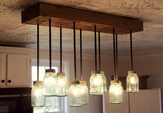 DIY Industrial Decor - Mason Jar Chandelier - Industrail Shelves, Furniture, Table, Desk, Cart, Headboard, Chandelier, Bookcase - Easy Pipe Shelf Tutorial - Rustic Farmhouse Home Decor on A Budget - Lighting Ideas for Bedroom, Bathroom and Kitchen http://diyjoy.com/diy-industrial-decor