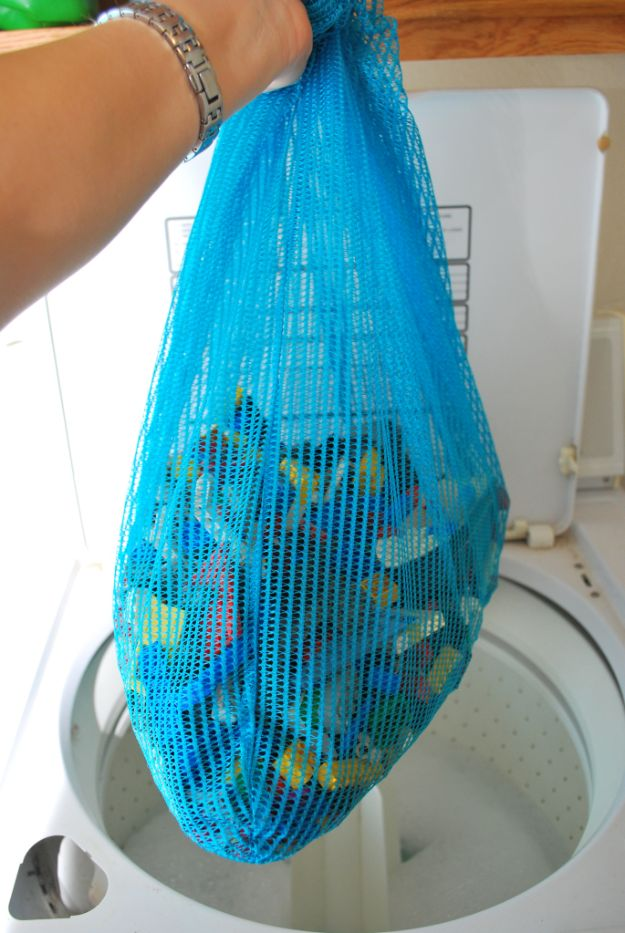 Laundry Hacks - Wash Toys In A Mesh Bag - Cool Tips for Busy Moms and Laundry Lifehacks - Laundry Room Organizing Ideas, Storage and Makeover - Folding, Drying, Cleaning and Stain Removal Tips for Clothes - How to Remove Stains, Paint, Ink and Smells - Whitening Tricks and Solutions - DIY Products and Recipes for Clothing Soaps http://diyjoy.com/laundry-hacks