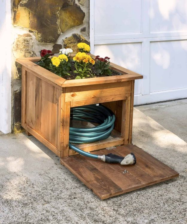 DIY Outdoor Furniture - DIY Pallet Wood Hose Holder with Planter - Cheap and Easy Ideas for Patio and Porch Seating and Tables, Chairs, Sofas - How To Make Outdoor Furniture Projects on A Budget - Fmaily Friendly Decor Kids Love - Quick Projects to Make This Weekend - Swings, Pallet Tables, End Tables, Rocking Chairs, Daybeds and Benches http://diyjoy.com/diy-outdoor-furniture