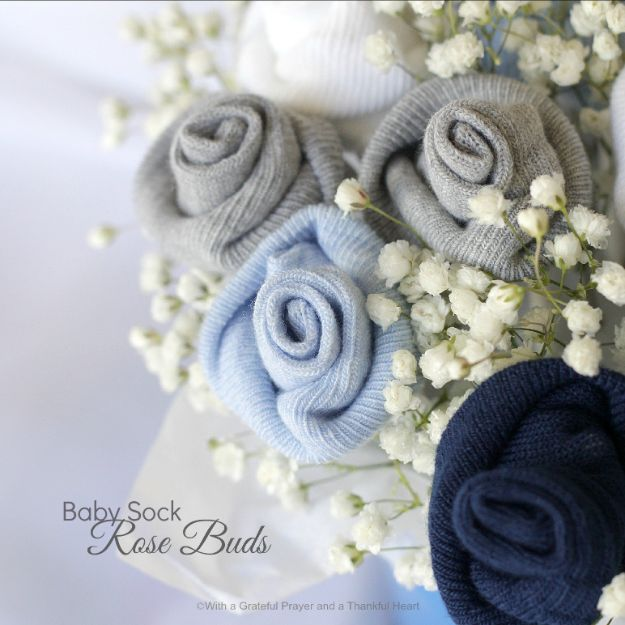 DIY Baby Shower Decorations - DIY Baby Socks Rose Flower Bouquet - Cute and Easy Ways to Decorate for A Baby Shower Ideas in Pink and Blue for Boys and Girls- Games and Party Decor - Banners, Cake, Invitations and Favors http://diyjoy.com/diy-baby-shower-decorations