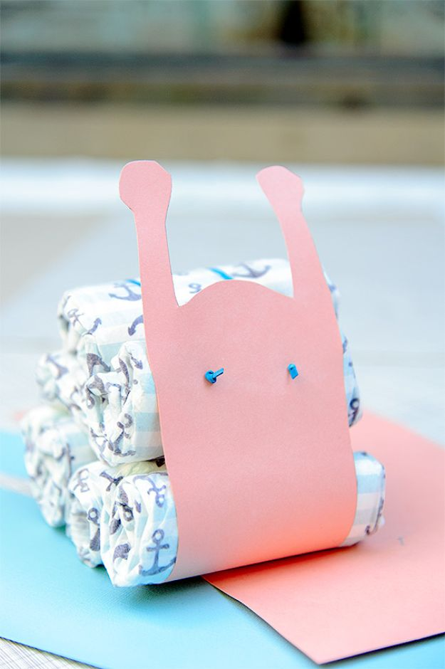 DIY Baby Shower Decorations - DIY Diaper Snails - Cute and Easy Ways to Decorate for A Baby Shower Ideas in Pink and Blue for Boys and Girls- Games and Party Decor - Banners, Cake, Invitations and Favors http://diyjoy.com/diy-baby-shower-decorations