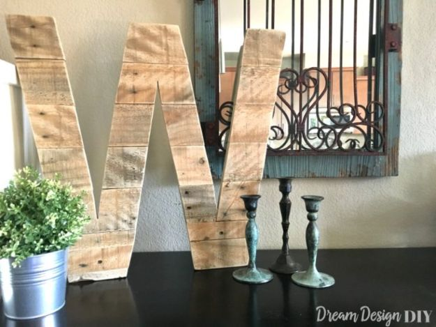 Cheap DIY Living Room Decor Ideas -DIY Pallet Wood Letter - Cool Modern, Rustic Creative Farmhouse Home Decor On A Budget - Do It Yourself Coffee Tables, Wall Art, Rugs, Pillows and Chairs. Step by Step Tutorials and Instructions http://diyjoy.com/cheap-diy-living-room-decor