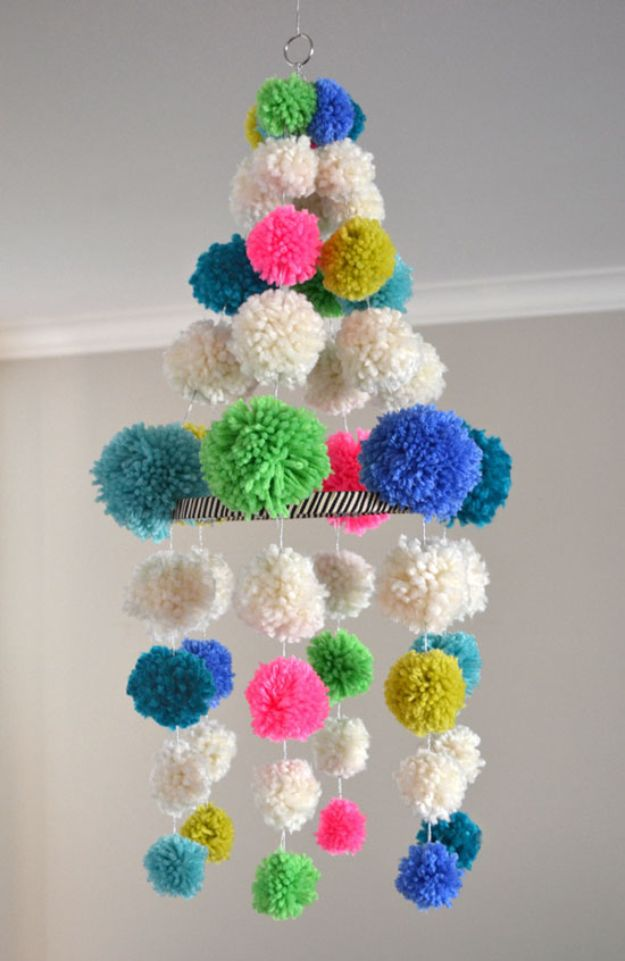 DIY Baby Shower Decorations - DIY Pom Pom Chandelier- Cute and Easy Ways to Decorate for A Baby Shower Ideas in Pink and Blue for Boys and Girls- Games and Party Decor - Banners, Cake, Invitations and Favors http://diyjoy.com/diy-baby-shower-decorations