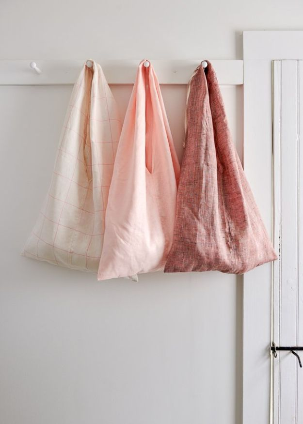 DIY Shopping Bags - Fold-Up Market Tote - Drawstring Bag Tutorials - How To Make A Shopping Bag - Use Fabric Scraps, Old Denim Jeans, Upcycled Items - Cute Monogrammed Ideas, Painted Bags and Sewing Tutorials for Beginners http://diyjoy.com/diy-drawstring-bags