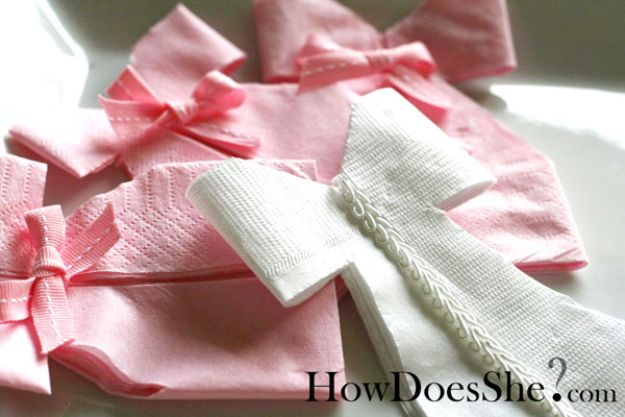 DIY Baby Shower Decorations - Napkin Dress Tutorial - Cute and Easy Ways to Decorate for A Baby Shower Ideas in Pink and Blue for Boys and Girls- Games and Party Decor - Banners, Cake, Invitations and Favors http://diyjoy.com/diy-baby-shower-decorations