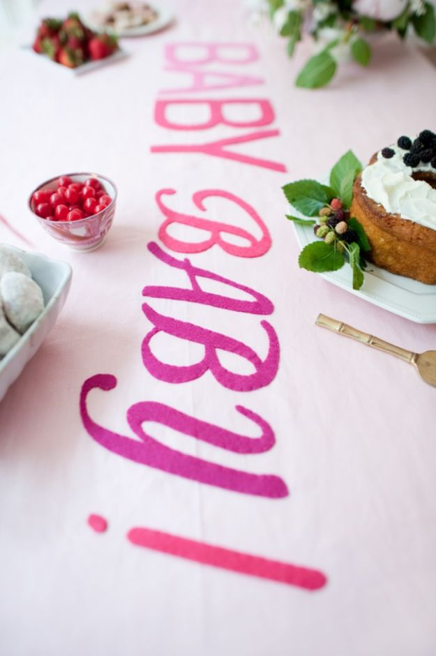 DIY Baby Shower Decorations - Oh Baby Tablecloth DIY - Cute and Easy Ways to Decorate for A Baby Shower Ideas in Pink and Blue for Boys and Girls- Games and Party Decor - Banners, Cake, Invitations and Favors http://diyjoy.com/diy-baby-shower-decorations