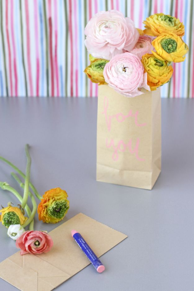 DIY Baby Shower Decorations - Paper Flower Sacks - Cute and Easy Ways to Decorate for A Baby Shower Ideas in Pink and Blue for Boys and Girls- Games and Party Decor - Banners, Cake, Invitations and Favors http://diyjoy.com/diy-baby-shower-decorations