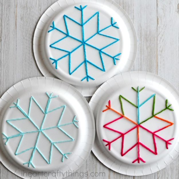 Winter Crafts for Toddlers and Kids - Paper Plate Snowflake Yarn Art - Easy Art Projects and Craft Ideas for 2 Year Olds, Preschool Age Children - Simple Indoor Activities, Things To Make At Home in Wintertime - Snow, Snowflake and Icicle, Snowmen - Classroom Art Projects - Busy Bags and Quick and Easy Gifts - Cheap Kid Crafts From The Dollar Store and Dollar Tree http://diyjoy.com/winter-crafts-for-kids