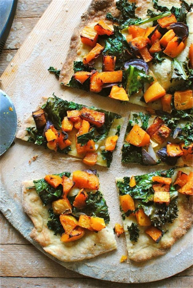 Butternut Squash Recipes - Roasted Butternut Squash and Kale Pizza - Healthy and Hearty Butter Nut Recipe Ideas for Soup, Roasted, Baked, Instant Pot, Crockpot, Mashed- Pasta, Salad, Dessert and Easy Side Dishes - Paleo,and Gluten Free Versions, Thanksgiving Favorites http://diyjoy.com/butternut-squash-recipes