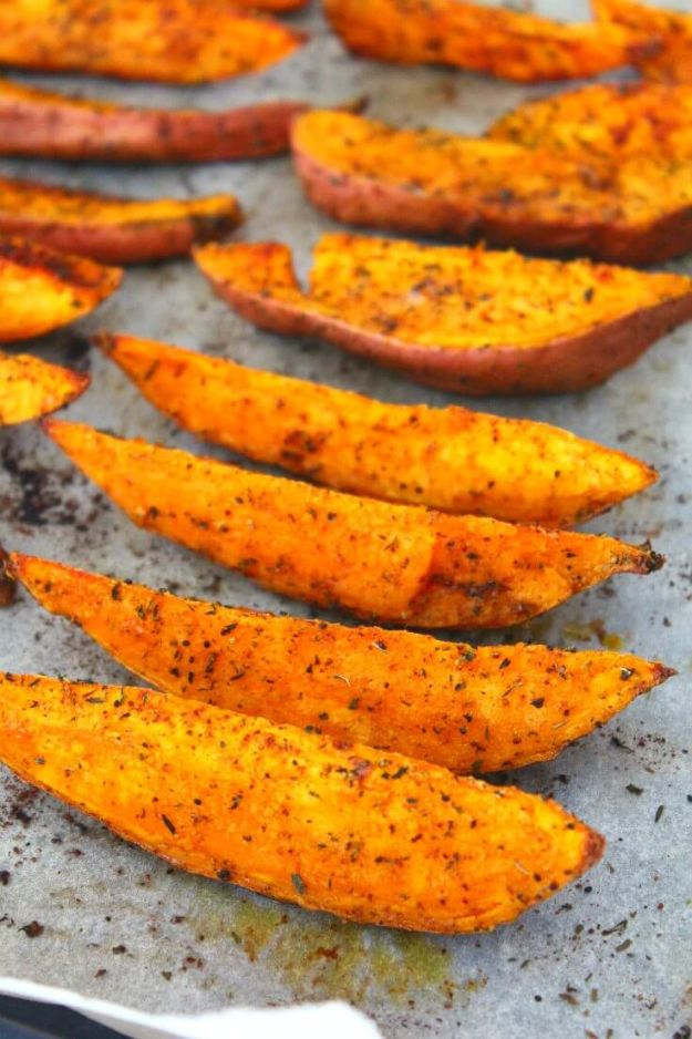 Sweet Potato Recipes - Spiced herb Roasted Sweet Potato Wedges - Easy Recipe Ideas for Sweet Potatoes in the Crockpot, Casserole Dishes, Baked, Mashed, Candied and Roastedd - Healthy Versions of Sweet Potatoes for Thanksgiving - Dinner, Lunch and Side Dishes #recipes