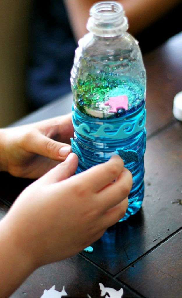 Easy Crafts for Kids - Ocean Glitter Bottles - Quick DIY Ideas for Children - Boys and Girls Love These Cool Craft Projects - Indoor and Outdoor Fun at Home - Cheap Playtime Activities #kidscrafts