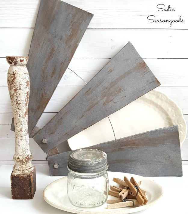 Magnolia Homes Decor Ideas - Windmill Wall Decor using Ceiling Fan Blades - DIY Decor Inspired by Chip and Joanna Gaines - Fixer Upper Dining Room, Coffee Tables, Light Fixtures for Your House - Do It Yourself Decorating On A Budget With Farmhouse Style Decorations for the Home http://diyjoy.com/magnolia-homes-decor-ideas