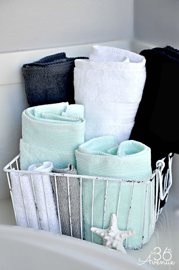 Cheap Bathroom Decor Ideas - Wire Basket Bathroom Towel Storage - DIY Decor and Home Decorating Ideas for Bathrooms - Easy Wall Art, Rugs and Bath Mats, Shower Curtains, Tissue and Toilet Paper Holders https://diyjoy.com/cheap-diy-bathroom-decor