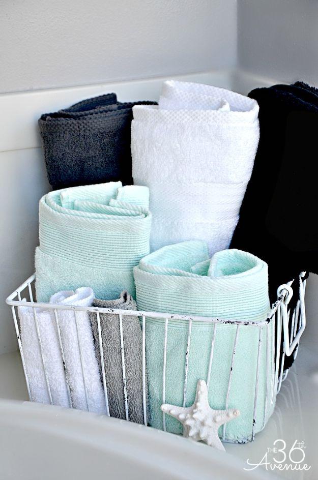Cheap Bathroom Decor Ideas - Wire Basket Bathroom Towel Storage - DIY Decor and Home Decorating Ideas for Bathrooms - Easy Wall Art, Rugs and Bath Mats, Shower Curtains, Tissue and Toilet Paper Holders https://diyjoy.com/cheap-diy-bathroom-decor