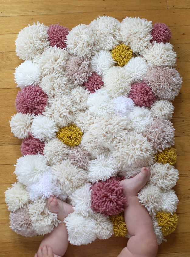 DIY Nursery Decor Ideas for Girls - DIY Easy Pom Pom Rug - Cute Pink Room Decorations for Baby Girl - Crib Bedding, Changing Table, Organization Idea, Furniture and Easy Wall Art