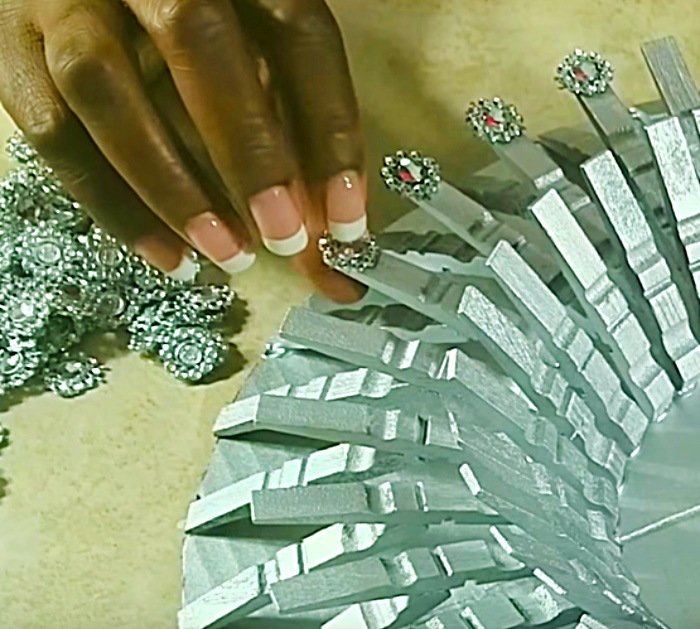 Learn to make a DIY gold clothespin mirror wall art piece for your home decor
