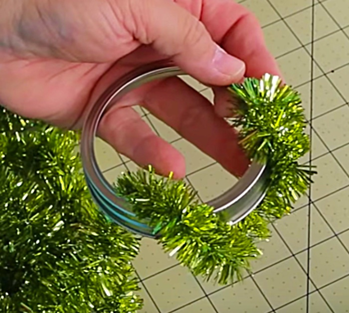Learn to make DIY cheap Dollar Tree Mason Jar Lid Wreath Ornaments
