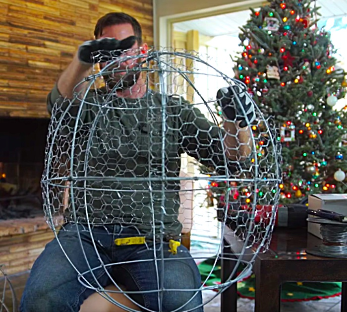 Try this cheap chicken wire and fairy light giant Christmas Ball For your outdoor decor