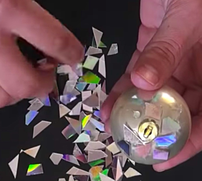Learn to make this quick easy DIY Disco Ball Christmas Ornament using old CDs