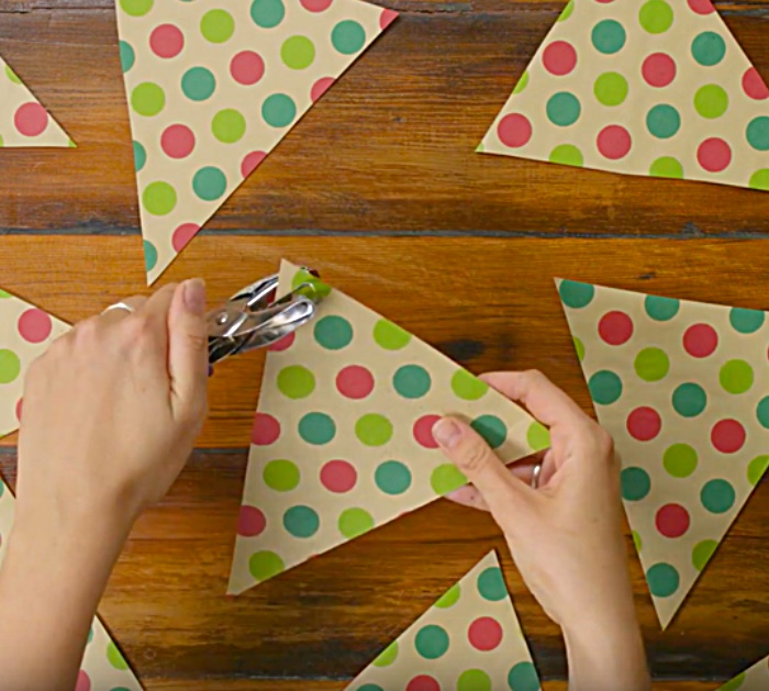 Learn to make a DIY flag garland from old wrapping paper
