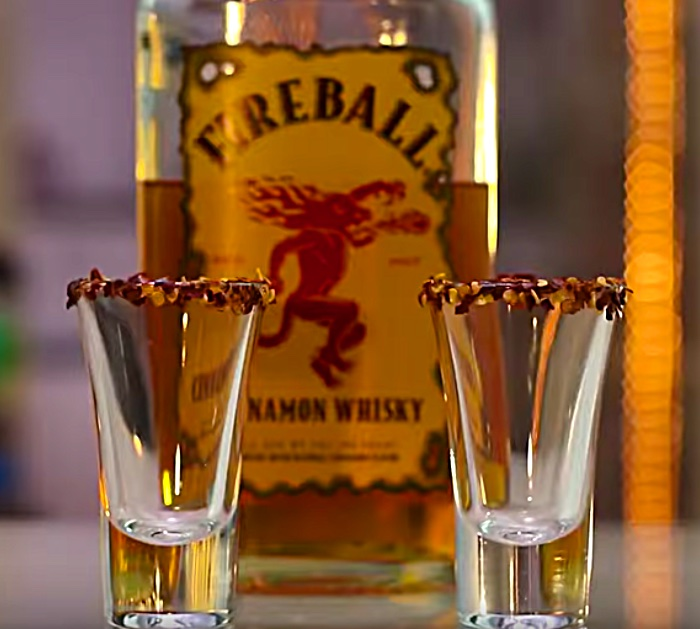 Learn to make a flaming German Shot with jagermeister, 151 Bacardi, and Fireball