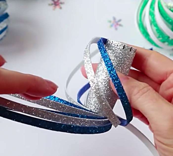 Learn to make these cheap easy DIY Foam Swirl Christmas ornaments with glitter foam paper and a hot glue gun