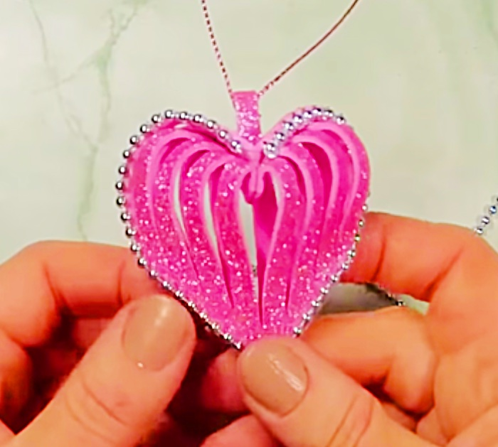 Learn to make a glitter foam DIY heart ornament with foam from Michaels Craft Store