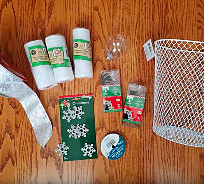 Learn to make a DIY Mesh Angel using a waste paper basket