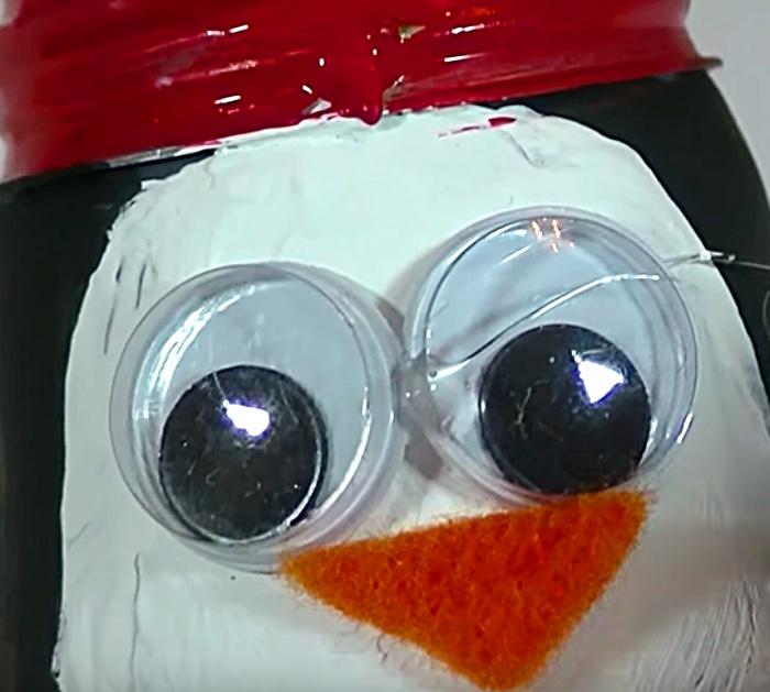 Learn this DIY Penguin Ornament Idea using Light Bulbs and paint