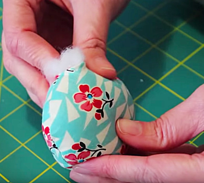 Learn to sew a DIY Petal Pincushion from fabric scraps and poly stuffing