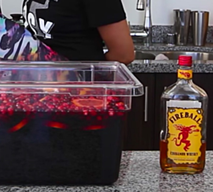 Try a boozy Merlot, vodka, and Fireball Devil's Jungle juice Party Punch For Christmas guests