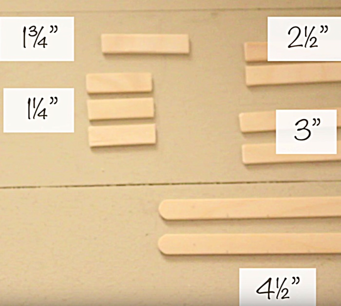 Learn to make a DIY Sled and Skis Ornament from popsicle sticks and craft paint