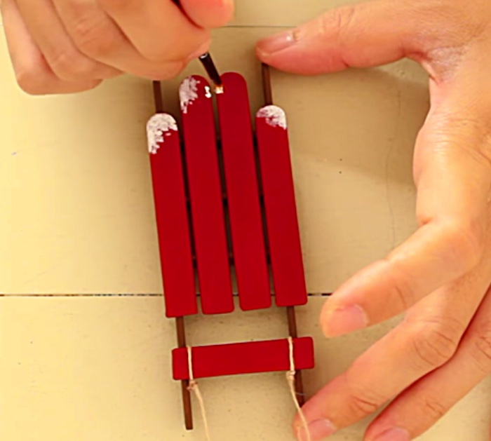 Try making a DIY Sled and Skis Ornament from popsicle sticks and craft paint