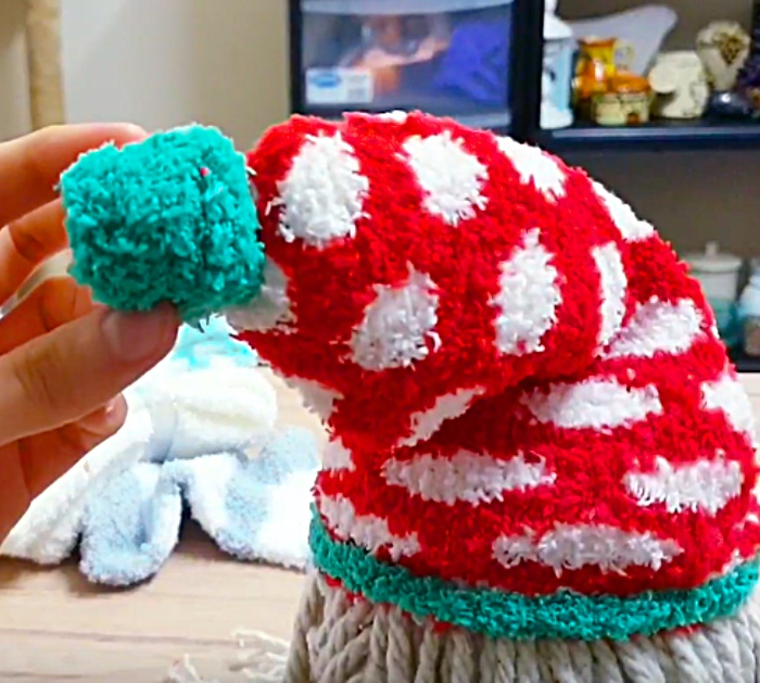Learn to make a DIY Sock Gnome for Christmas out of rice and Dollar Tree Items