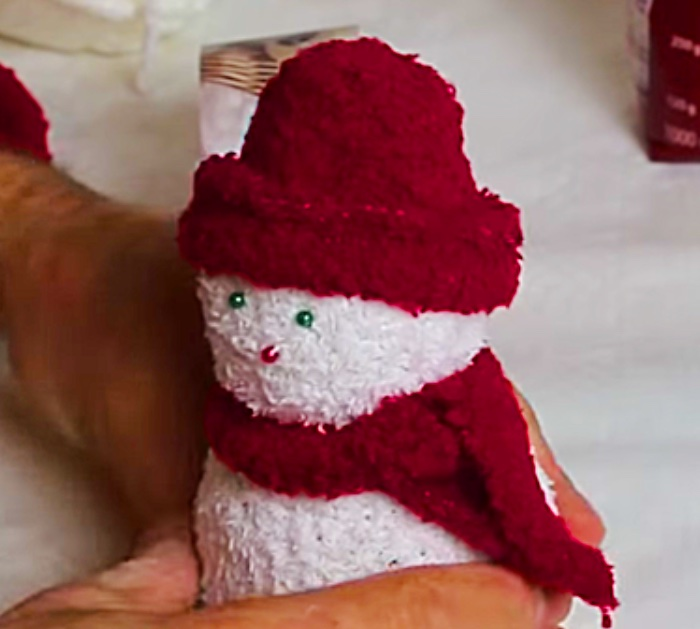 Learn to make this quick easy cheap DIY sock snowman with socks and rice