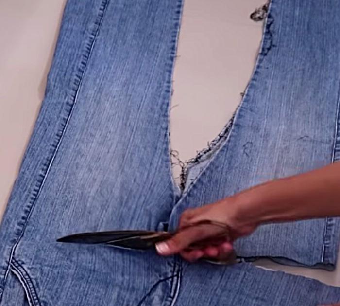 Make a long denim woman's vest out of a large pair of men's jeans