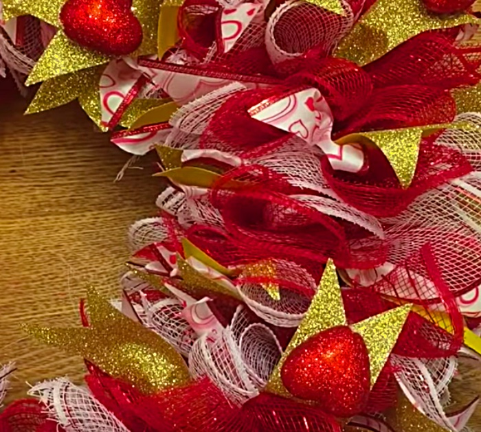 Make a cute cheap DIY Mesh Wreath with materials from Dollar Tree