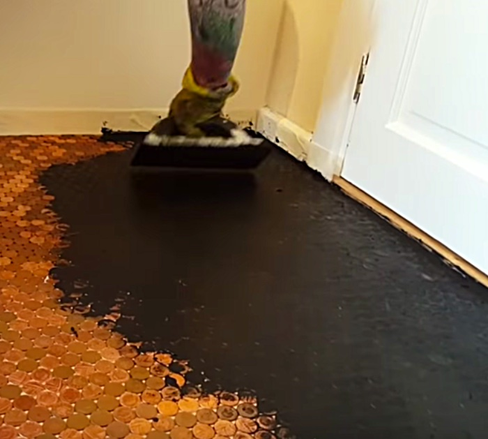 Try a new idea in the bathroom or kitchen by making an epoxy floor made with pennies