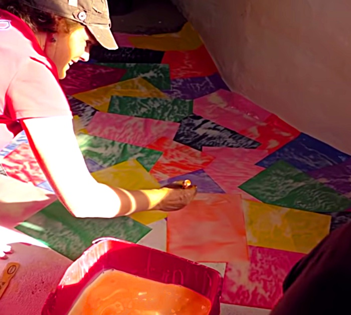 Make a colored paper floor with construction paper from the craft store
