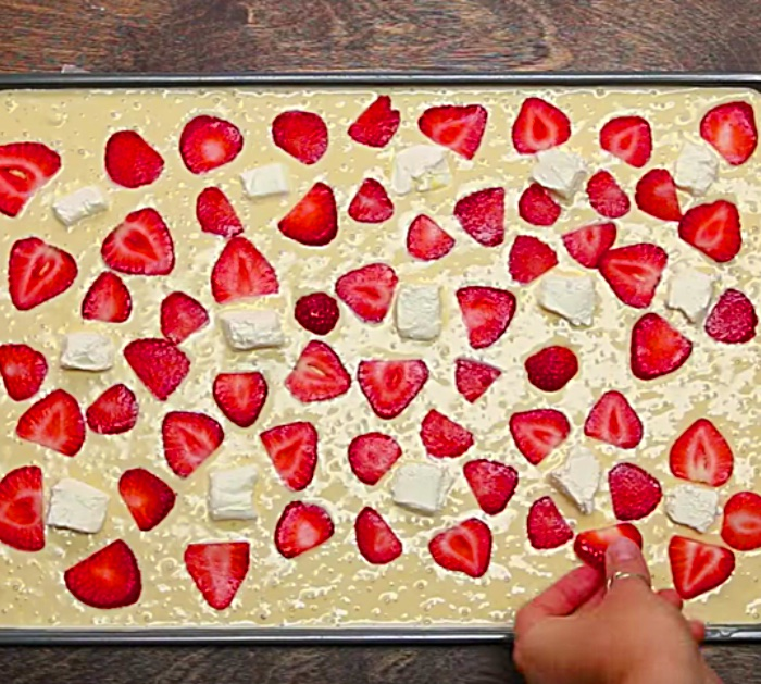 Make sheet pan pancakes with strawberries and bananas