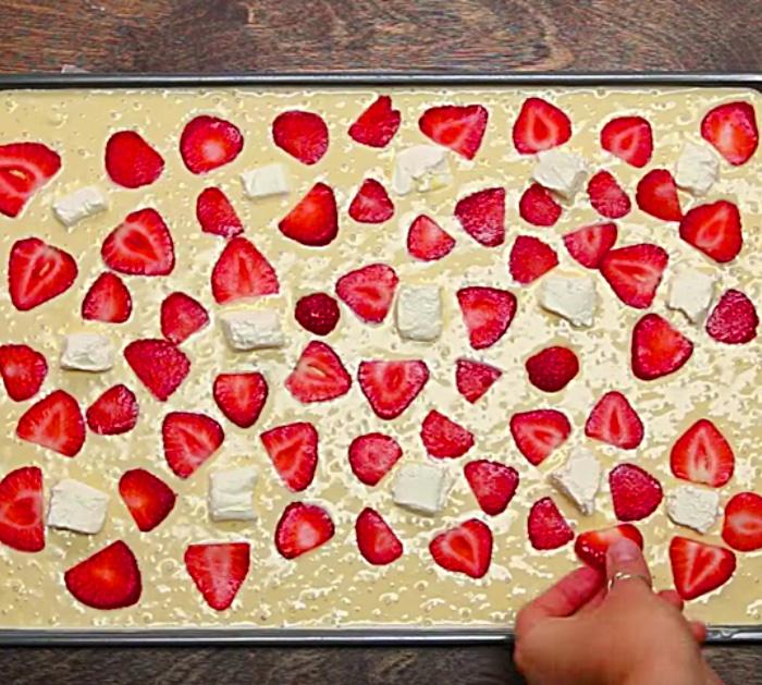 Make sheet pan pancakes with strawberries and bananas