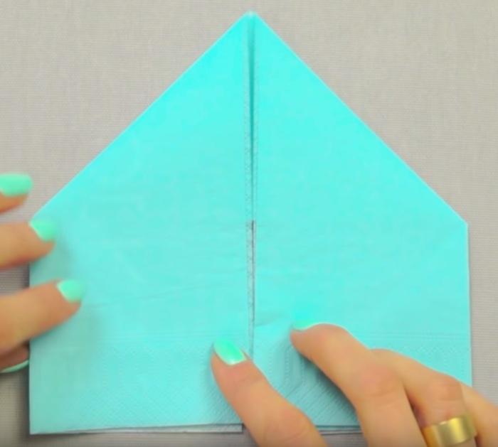 Fold a paper napkin like a bunny